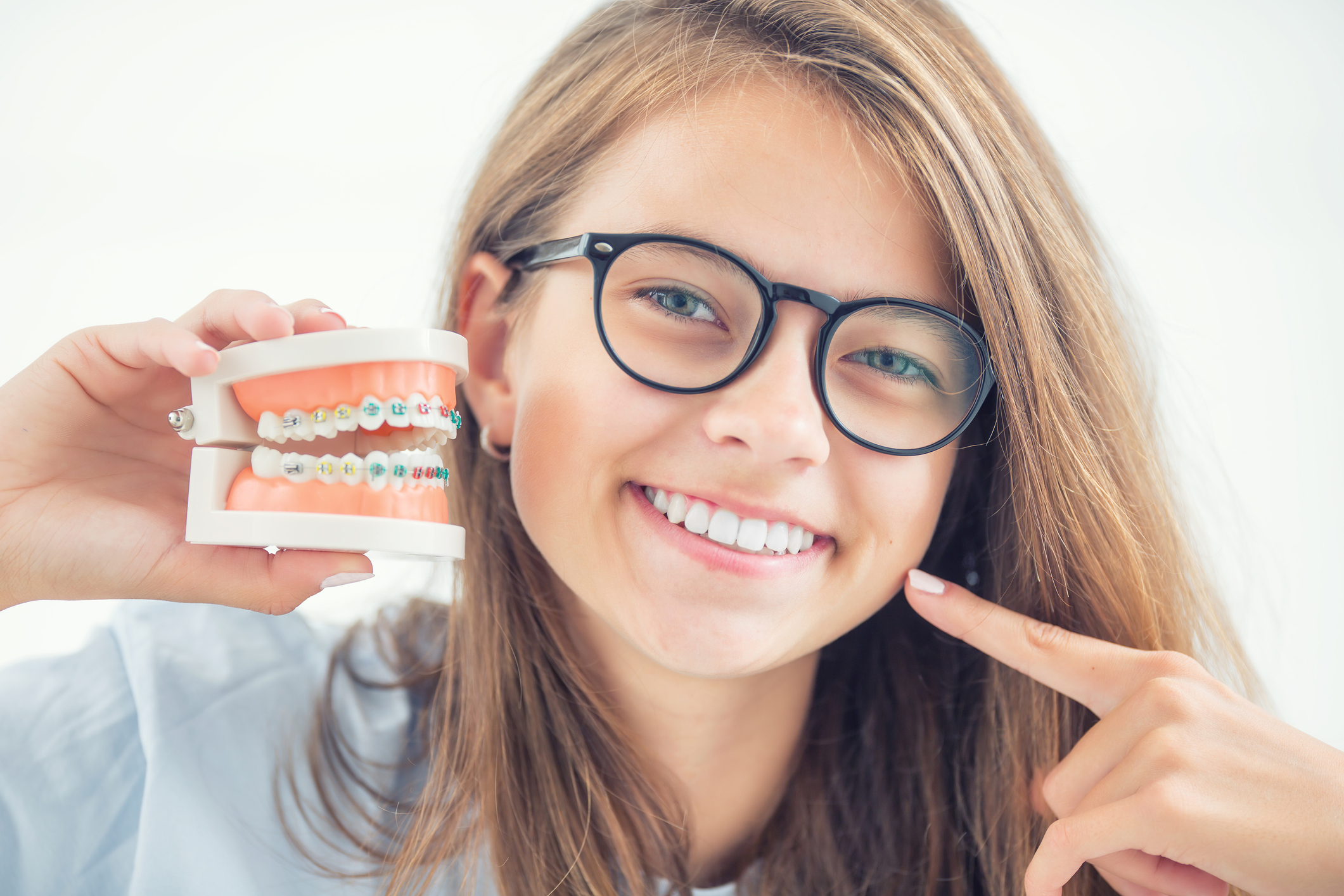 Smiling Woman Holding Braces Model